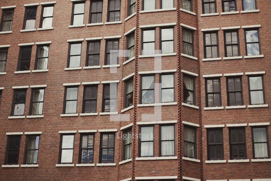 Windows of a brick apartment building