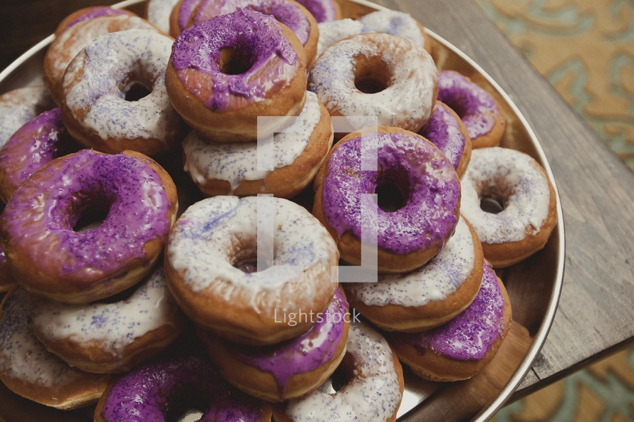 Glazed doughnuts with colored icing
