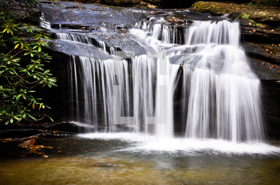 water rushing over a waterfall