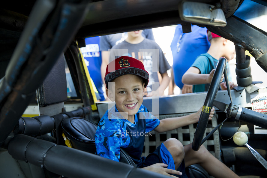 child in a Nascar vehicle