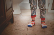feet of a little boy in socks and pajamas