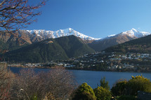 mountain range - snow covered - town below by water