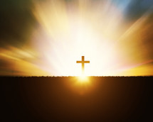 glowing horizon surrounding the silhouette of a cross