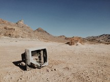 broken tv in a desert
