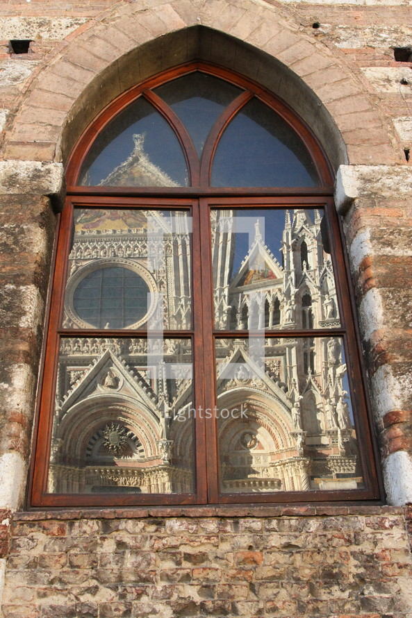 Reflection of Siena Cathedral in a window