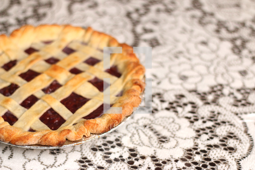 cherry pie on white lace
