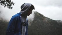man in a hoodie looking down