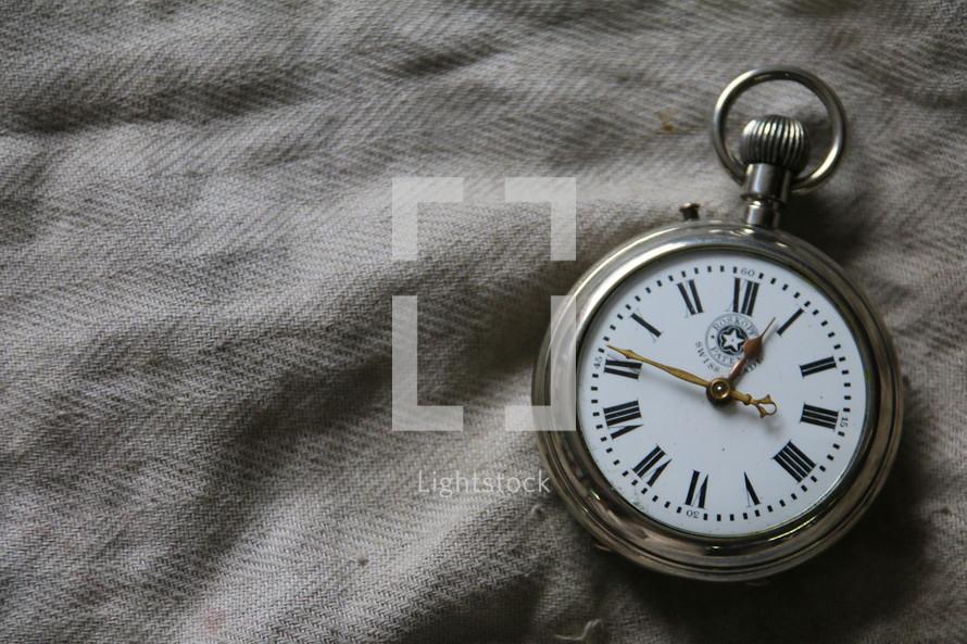 Antique pocket watch with roman numerals