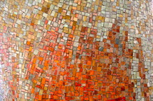 A tile mosaic of many colors.