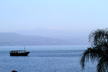Boat on the Sea of Galilee with mountain in the background