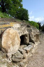 Empty tomb with the stone rolled away in Israel