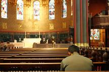 Man praying in beautiful old church