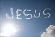 Jesus name written in the clouds
