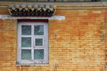 Window in a yellow brick Mongolian wall