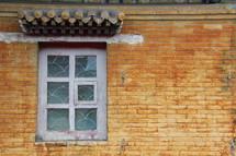 Window in a yellow brick Mongolian wall