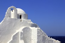 White washed Greek church overlooking the sea