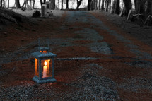 lantern on gravel road
