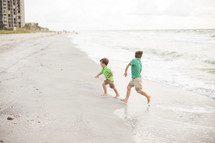 brother's running on a beach