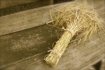 Bundle of wheat on old wooden table
