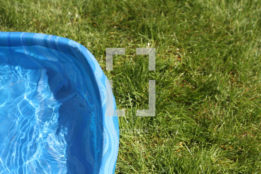 plastic pool in the grass