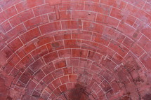 Red clay bricks laid in a circular pattern