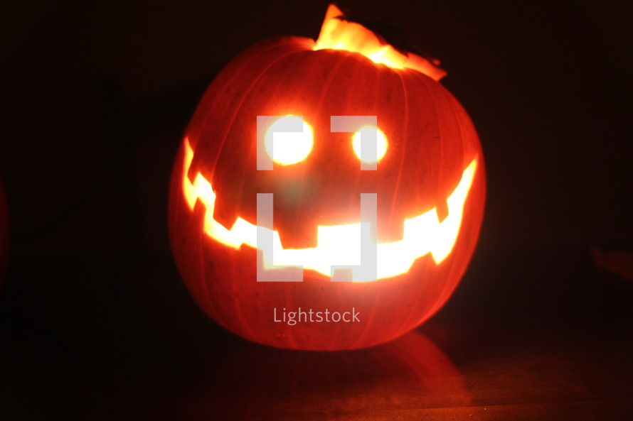 candle in a jack-o-lantern