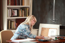 an artist drawing at her desk