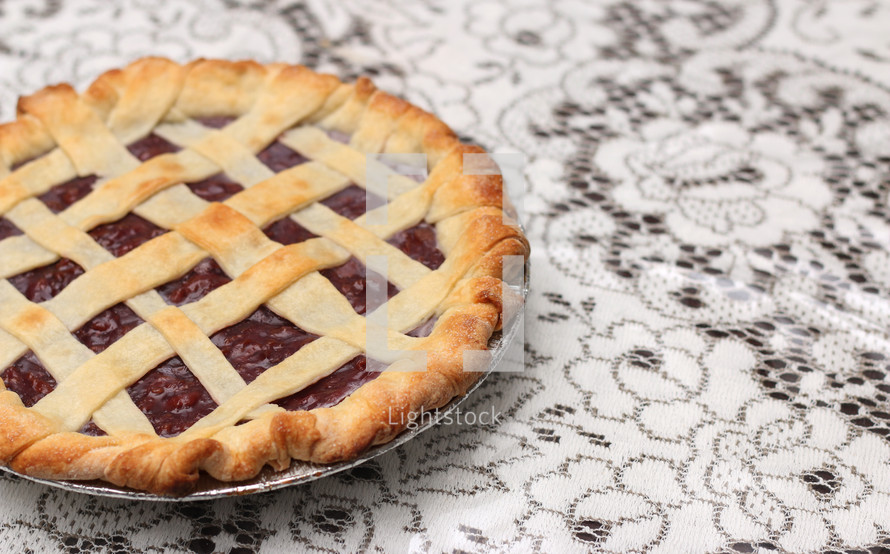 cherry pie on white lace