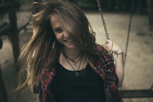 teen girl on a swing