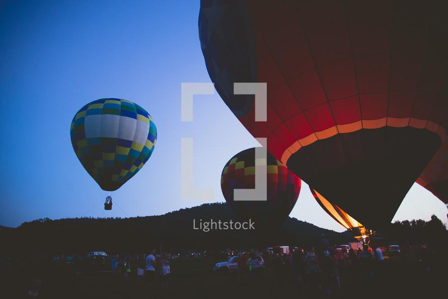 hot air balloons lifting up