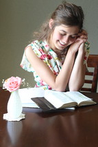 A girl studying the Bible.