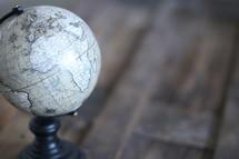 globe on a wood trunk