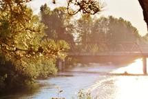 water under a bridge and intense sunlight