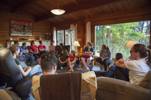 teens on a retreat sitting around having a discussion