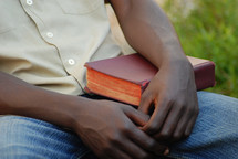 man resting with a Bible