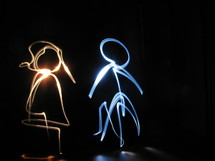 man and woman in lights