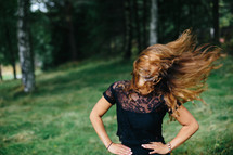 a woman tossing her hair