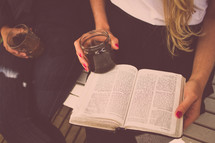 friends reading and discussing the Bible