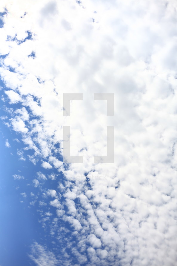 White clouds in a blue sky.