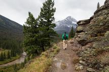 man hiking on a mountain trail