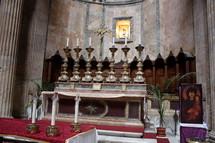 candlesticks at an altar