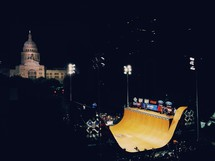skate ramp at night and the Austin, TX capital building in the distance