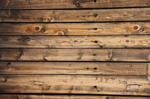 Wooden planks siding a log cabin