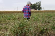 a child walking on farmland