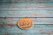 give thanks on teal wood boards
