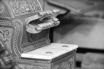 An antique cash register, the source of the expression 'Ka-ching'.
