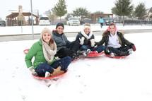 teens on sleds