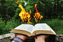 flames from the pages of a Bible