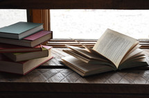 books in a window sill
