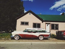vintage station wagon in front of a house